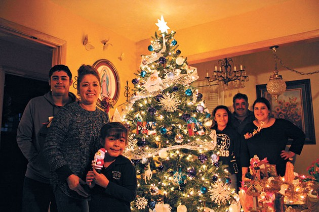 The Chavez family of south Oklahoma City spends Christmas Eve with members of their extended family for a traditional Posada celebration that includes re-enacting Mary and Joseph's journey to Bethlehem.   Photo Laura Eastes