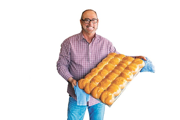 Photos of Jimmy Collins with pans of his yeast rolls shared on social media bring in customers from around the region. (Photo provided)