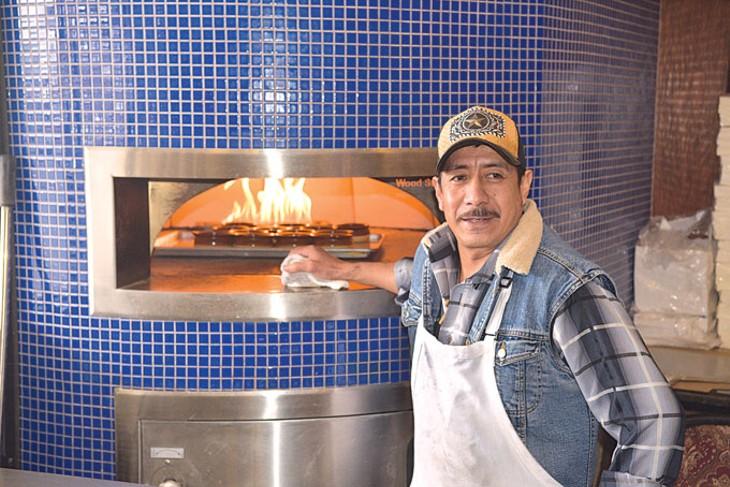 Rodrigo Garcia watches over rice pudding in Fusion's brick oven.   Photo Jacob Threadgill