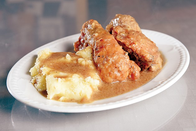 Smothered chicken and mashed potatoes at Florence's Restaurant in Oklahoma City, Thursday, March 3, 2016.  (Garett Fisbeck) - GAZETTE / FILE