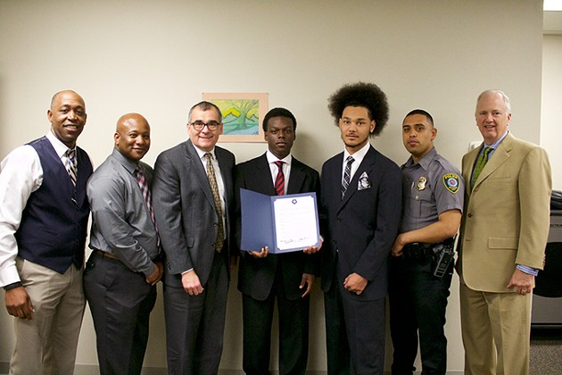 from left Lt. Wayland Cubit, Warren Pete, Steve Buck, Quavyon Durham, Brandon McDonald, Sgt. Tony Escobar and Tony Caldwell attended an Office of Juvenile Affairs Board meeting during which Durham and McDonald were honored for their participation in Man UP. - PROVIDED