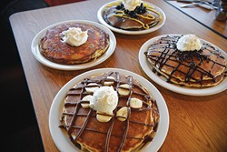 Banana-Nutella, blueberry, chocolate chip and pineapple upside-down cake pancakes from Sunnyside Diner - JACOB THREADGILL