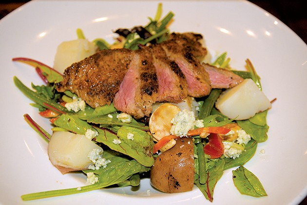 The lunch menu includes a steak salad tossed with champagne vinaigrette. - JACOB THREADGILL