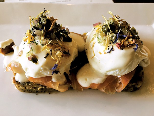 "Ludivine's lox Benedict returns to its brunch menu with an ""evertyhing"" bread pudding topped with house-cured salmon, poached eggs, cream cheese fondue and red onion dill caper relish. - JACOB THREADGILL"
