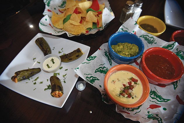 Stuffed jalapeños are joined by queso, guacamole and two salsas. - JACOB THREADGILL