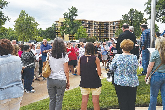 Dozens gather for the weekly Vigil for Immigration Justice, a multi-deonominational show of support for immigrant communities. Many vigil attendees voiced frustrations with the enforcement of family-separating policies on the nation's southern border. - BEN LUSCHEN