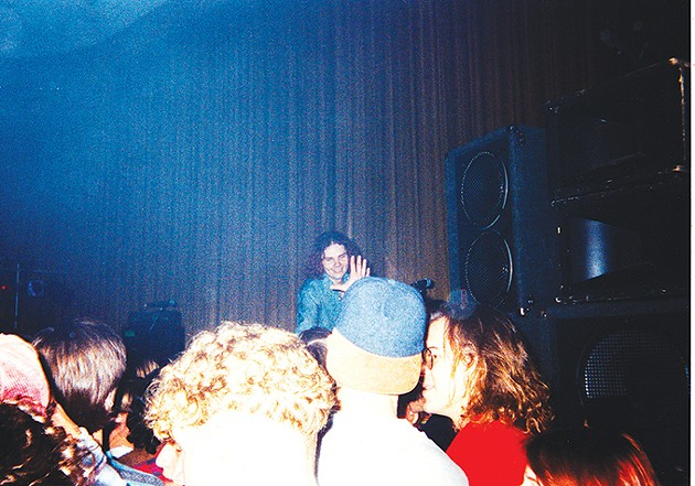 In a Dec. 12, 1991 photo, Billy Corgan of The Smashing Pumpkins smiles at the audience in Norman's Hollywood Theatre. - BARB HENDRICKSON VEST / PROVIDED