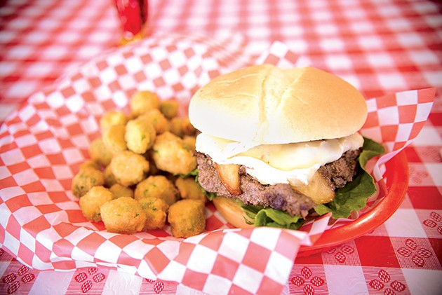 The French Brie Cheeseburger topped with crispy apples and a special sauce and a side of fried okra. - JACOB THREADGILL