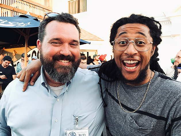 "New Health Solutions Oklahoma executive director Bud Scott left poses for a photo with local rapper and artist Mike ""Huckwheat"" Huckeby right during the official Yes on 788 election night watch party at 51st Street Speakeasy. - SEAN VALI / PROVIDED"