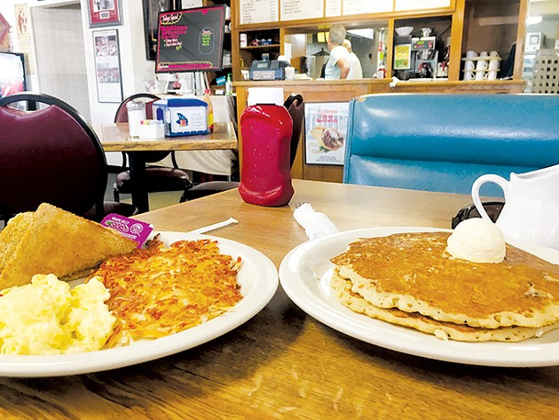 Pecan-filled pancakes are joined by excellent hash browns, eggs and toast. - JACOB THREADGILL