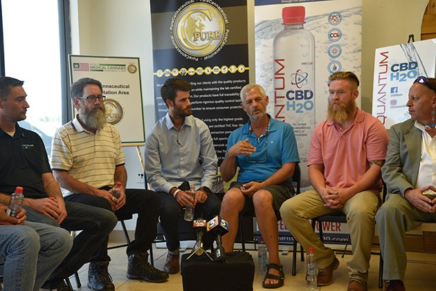 from left Oklahoma Cannabis Trade Association members Ryan Early, Chris Moe, Chance Gilbert, Chip Paul, Kyle Early and Scott Huffman hold a news conference at Can-Tek Labs. - BEN LUSCHEN