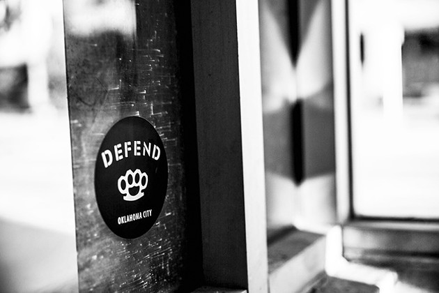 Defend OKC stickers were spotted several weeks ago around the Midtown and downtown areas. Some people have accused the brand of representing white nationalist ideals, but its founder denies the association. - PROVIDED