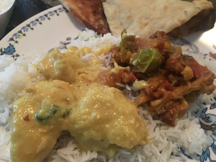 Chicken qorma and allo gobi with naan. - JACOB THREADGILL
