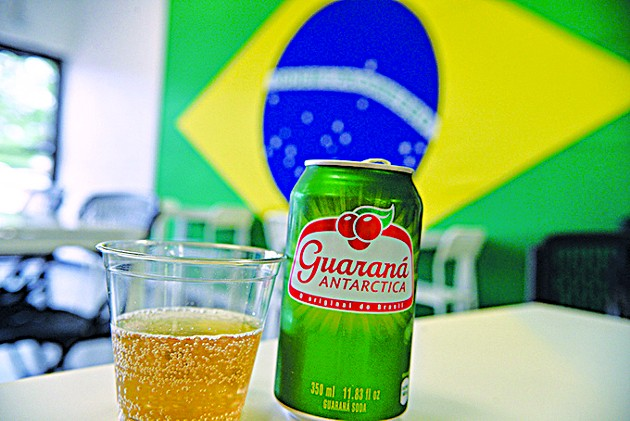 Soda made from the guarana berry is highly sought-after by Brazilian expats who come into Moore de Brasil. - JACOB THREADGILL