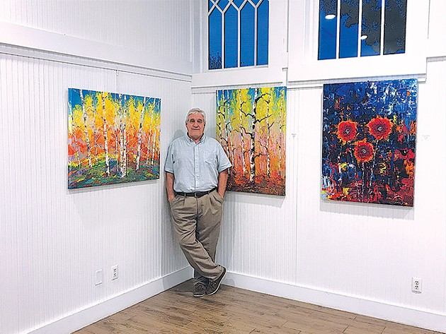 Tim Kenney with a few of his works in the A Burst of Color exhibit at The Depot in Norman. - TIM KENNEY / PROVIDED