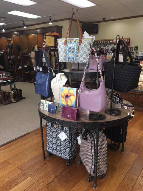 In addition to a large selection of footwear, Daniels Shoes offers Brighton handbags and luggage. - KIMBERLY LYNCH
