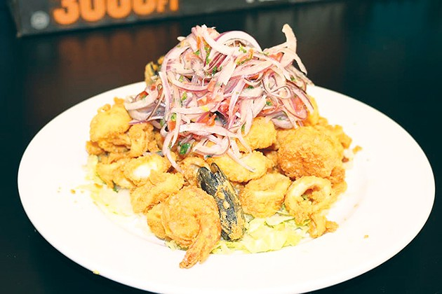 Jalea Mixto is tempura-fried seafood with lime-marinated onions. - PROVIDED