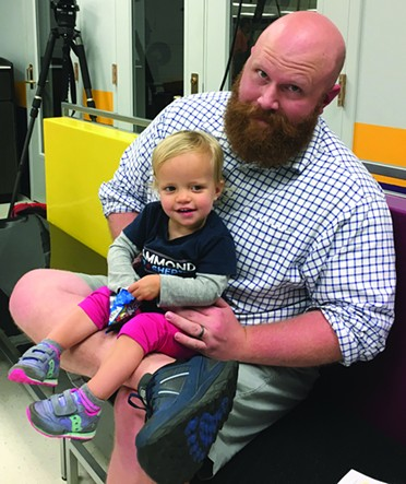 Kevin Hammond, a candidate for Cleveland County sheriff, and his 2-year-old daughter Rori attended Warren's speech and talked to Oklahoma Gazette about students' need for good healthcare in order to focus on their studies. - NAZARENE HARRIS