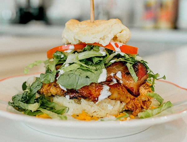 A club sandwich with fried chicken, lettuce, tomato and bacon from HunnyBunny Biscuit Co. - ALEXA ACE