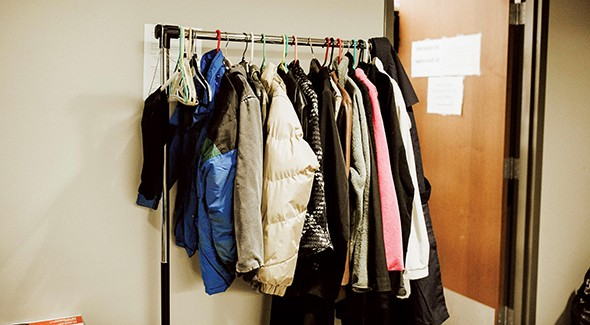 Coats hang on a rack in a hall at The Homeless Alliance of Oklahoma City. - ALEXA ACE
