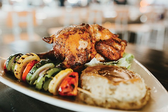 Smoked beer can chicken is one of the most popular items at Industry Gastro Lounge. - ALEXA ACE
