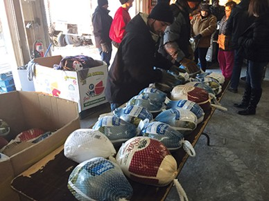 Volunteers prepare turkeys for distribution at Jesus House. - JESUS HOUSE / PROVIDED