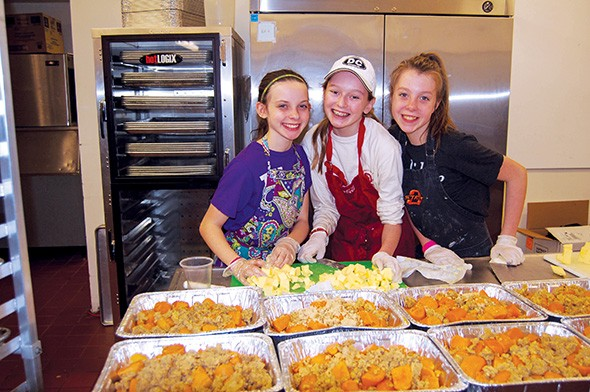 Volunteers of all ages help Dinner With Love package dinners and deliver them to families. - DINNER WITH LOVE / PROVIDED