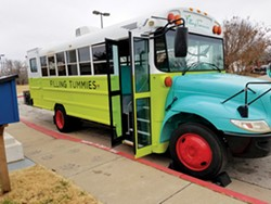 The Filling Tummies mobile food pantry is a brightly colored school bus that travels to schools, low-income apartment complexes, senior centers and afterschool programs offering free, fresh food. - PROVIDED