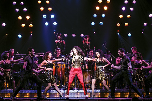 Christie Prades center plays Gloria Estefan in On Your Feet!  - MATTHEW MURPHY / PROVIDED