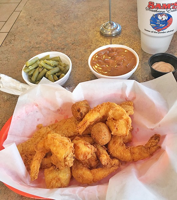 "Shrimp lives up to the restaurant's claim of ""home of the jumbo shrimp,"" along with fish and sides of green beans and red beans and rice. - JACOB THREADGILL"
