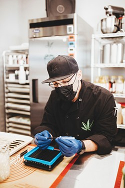 Fire Leaf recently hired cannabis chef Jeremy Cooper to organize its medical marijuana kitchen in its new Stockyards City location. - ALEXA ACE