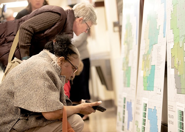 Community members examine the final district path map after the final recommendation was made Feb. 21. - MIGUEL RIOS