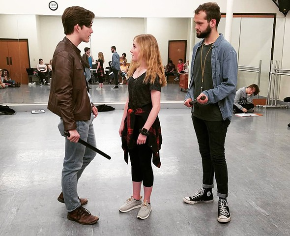 from left Logan Boyd, Ermily Trnka and Jackson Murray rehearse a scene from Urinetown: The Musical. - NICHOLAS BARTELL / PROVIDED