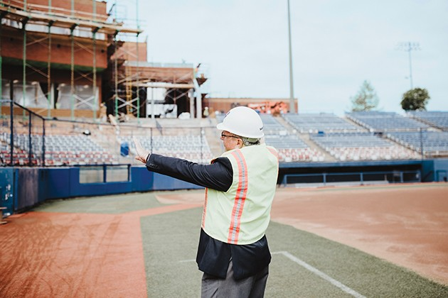 John Miller, USA Softball director of membership, details construction of a new two-story press box at OGE Energy Field. - ALEXA ACE