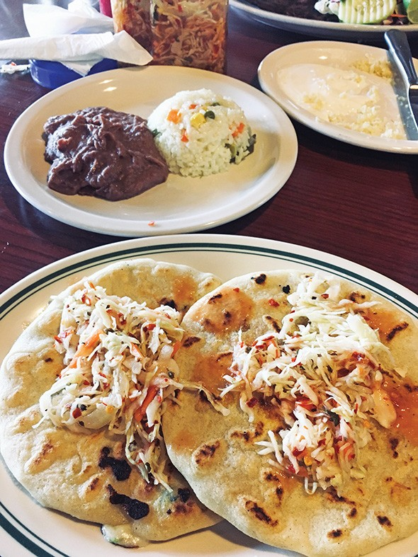 Pupusas topped with curtido, a marinated cabbage - slaw in vinegar and chile - JACOB THREADGILL