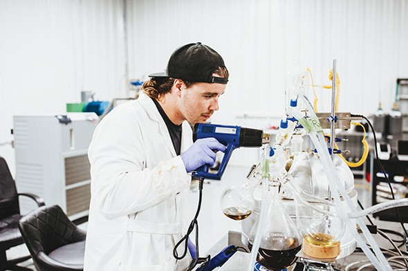 Laboratory workers at Releaf Labs process cannabis distillate for their vape cartridges. - ALEXA ACE