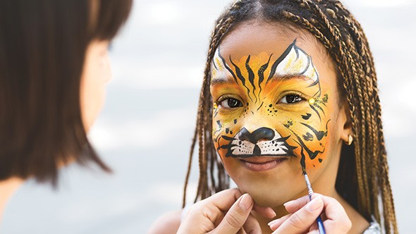Oklahoma City Pride's green zone features children's activities including face painting. - BIGSTOCK.COM