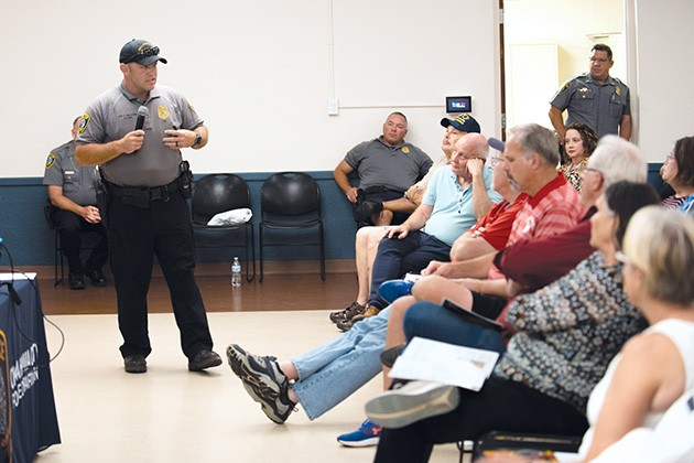 Sgt. Felix Valadez, one of two officers on the Homeless Outreach Team, speaks to community members at a town hall on homelessness. - MIGUEL RIOS