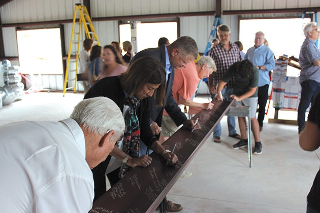 OKC Metro Alliance hosted a beam signing for Women's Firstep's new kitchen and dining room being built with funds from the Impact Oklahoma grant. - PROVIDED