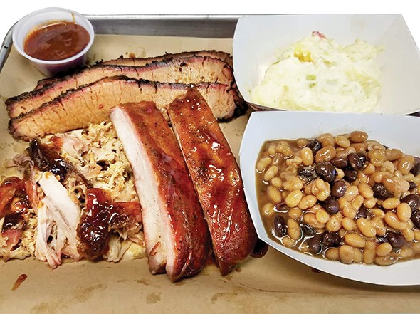 Brisket, pulled pork and ribs with potato salad and baked beans - PROVIDED