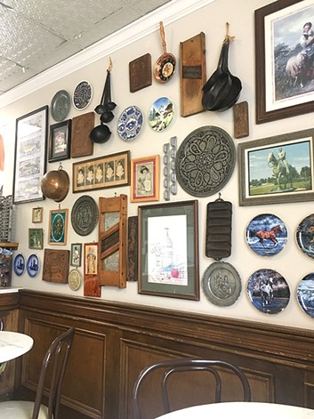 The walls inside The Brown Bag Deli are filled with Americana items. - JACOB THREADGILL