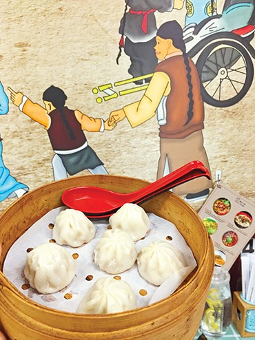 "Soup dumplings are listed on the menu at Yummy Noodles as ""little juicy pork buns."" - JACOB THREADGILL"
