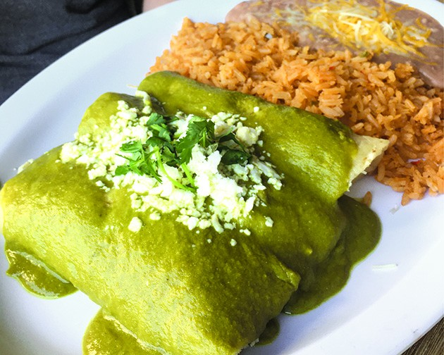 Chicken enchiladas with a poblano and sour cream sauce - JACOB THREADGILL