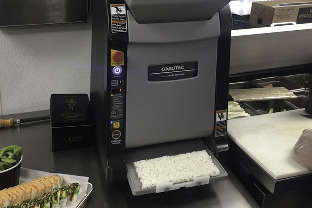 A Maki Maker produces as many as 1,300 pressed rectangles of sushi rice per hour. - JACOB THREADGILL