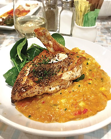 The salt-and-pepper chicken at Aurora with corn purée is on its new dinner menu. - JACOB THREADGILL