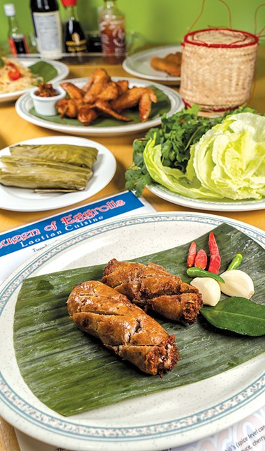 Lao sausage is pork mixed with garlic, lemongrass and other flavors before being stuffed in casings and deep-fried. - PHILLIP DANNER