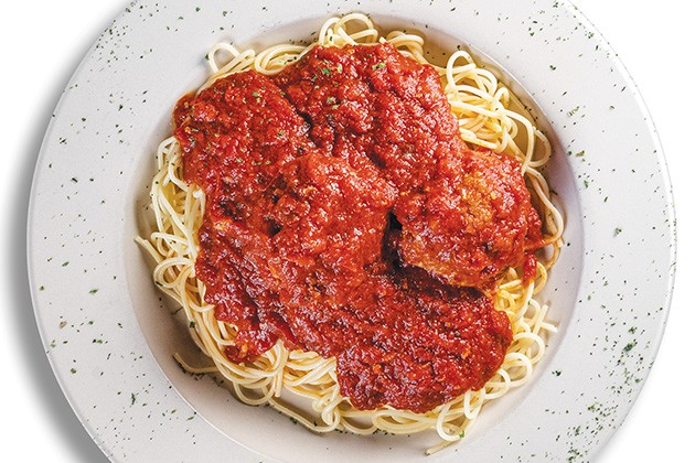 Meatballs and tomato gravy served over spaghetti - PHILLIP DANNER