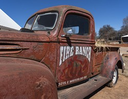 Fire Ranch Farms includes 23 buildings and a truck that serves as a sign. - NEISHA FORD