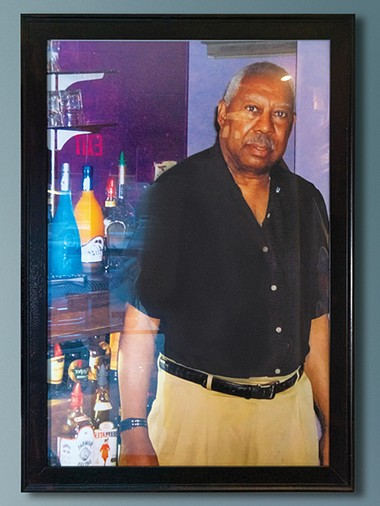 A portrait of Elmer's Uptown's founder Elmer Kemp hangs by the entrance. - PHILLIP DANNER