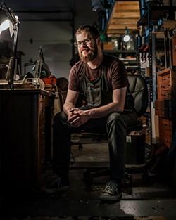 Arsenios Corbishley makes violins, violas and cellos in his shop in Farmers Market District. - NEISHA T. FORD